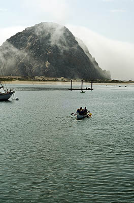 CA: South Coast Region, San Luis Obispo County, Pacific Coast Area, City of Morro Bay, Embarcadero, Canoeists paddle towards Morro Rock, shrowded in clouds [Ask for #271.015.]
