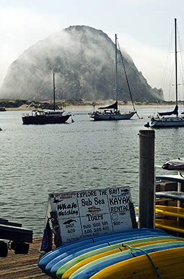CA: South Coast Region, San Luis Obispo County, Pacific Coast Area, City of Morro Bay, Embarcadero, View from a kayak rental across Morro Bay towards Morro Rock [Ask for #271.016.]