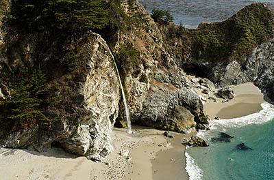 CA: South Coast Region, Monterey County, Los Padres National Forest, Big Sur, McWay Cove, Julia Pfeiffer Burns State Park, Waterfall flows over cliffs onto beach [Ask for #271.062.]