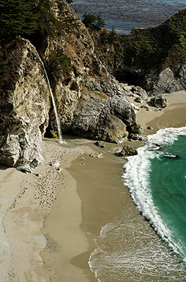 CA: South Coast Region, Monterey County, Los Padres National Forest, Big Sur, McWay Cove, Julia Pfeiffer Burns State Park, Waterfall flows over cliffs onto beach [Ask for #271.063.]