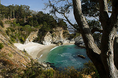 CA: South Coast Region, Monterey County, Los Padres National Forest, Big Sur, McWay Cove, Julia Pfeiffer Burns State Park, Waterfall flows over cliffs onto beach [Ask for #271.066.]