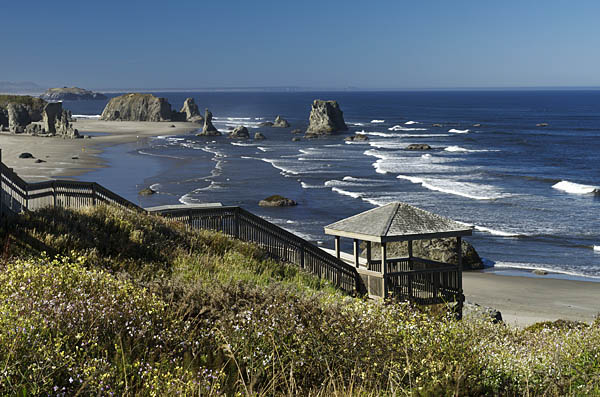 OR: South Coast Region, Coos County, Bandon Area, South Beaches, Cocquille Point, Stairs lead down a grassy cliff to a sand beach spotted with large hoodoos [Ask for #274.346.]