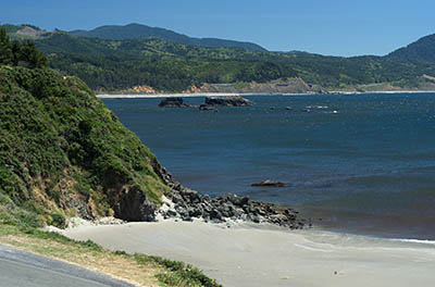 OR: South Coast Region, Curry County, North Coast, Port Orford Area, Town of Port Orford, Fort Point, Battle Rock, Sand beach a block from downtown, with views towards sea cliffs [Ask for #274.390.]