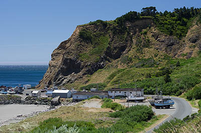 OR: South Coast Region, Curry County, North Coast, Port Orford Area, Town of Port Orford, Fort Point, Battle Rock, Sand beach a block from downtown, with views towards marina below sea cliffs [Ask for #274.395.]