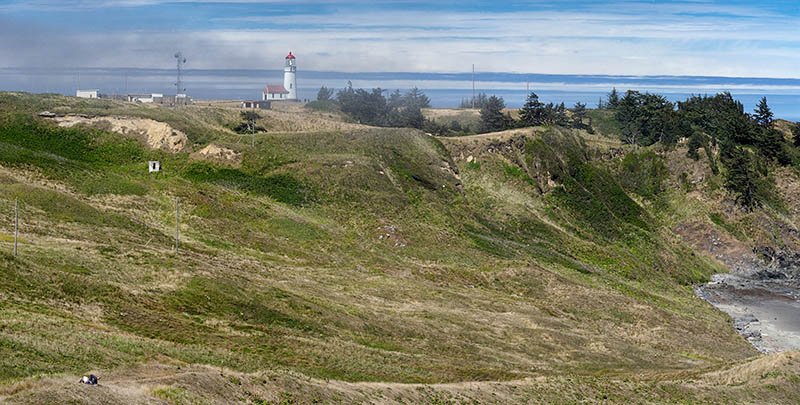 OR: South Coast Region, Curry County, North Coast, Cape Blanco Area, Cape Blanco State Park, View of the Cape Blanco Lighthouse atop grassy cliffs as fog rolls in. [Ask for #274.668.]
