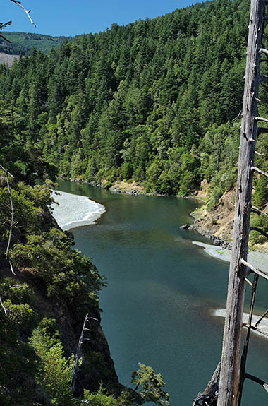 OR: Curry County, Coast Range, Rogue River Area, Illinois River Area. The Rogue River passes through a cliff-lined gorge; viewed from the byway [Ask for #274.786.]