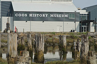 OR: South Coast Region, Coos County, Coos Bay Area, City of Coos Bay, Downtown, Waterfront, Coos Bay History Museum, Viewed over the pilings of a long-gone wharfside structure [Ask for #274.823.]