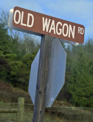 OR: South Coast Region, Coos County, The Coast Range, The Old Coos Bay Wagon Road. A county sign marks the Old Wagon Road at its intersection in Sumner Community.  [Ask for 276.243.]