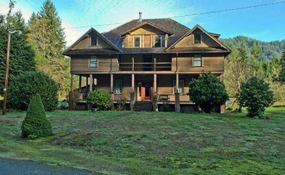 OR: South Coast Region, Coos County, Coast Range, Old Coos Bay Wagon Road, Dora Community, The Edwin and Ethel Abernethy House, built in the early 20th century as a travelers lodge and guest house, faces the Old Wagon Road. [Ask for #276.259.]