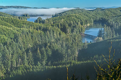 Whisps of morning fog hang on Lake Tahkenich.