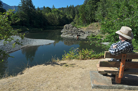 OR: Coos County, Coast Range, Coquille River Drainage, Powers Community. Self-portrait. Orchard Park. A park bench overlooks the swimming hole on the South Fork Coquille River, in a rock-lined gorge. [Ask for #277.057.]