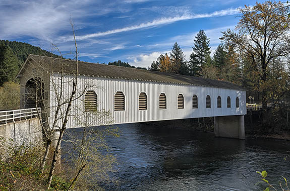 OR: Lane County, South Willamette Valley, Eugene Area, Goodpasture Covered Bridge. Oregon's longest covered bridge still in use, Goodpasture regularly carries logging trucks. [Ask for #277.387.]