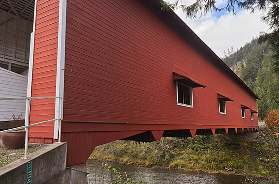 OR: Lane County, South Willamette Valley, Eugene Area, Office Covered Bridge. Red covered bridge, carrying traffic to a local park. At 180 feet, this is Oregon's longest covered bridge. [Ask for #277.401.]