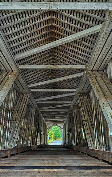 OR: Lane County, South Willamette Valley, Eugene Area, Office Covered Bridge. Red covered bridge, carrying traffic to a local park. At 180 feet, this is Oregon's longest covered bridge. Interior, showing details of Howe truss. [Ask for #277.403.]