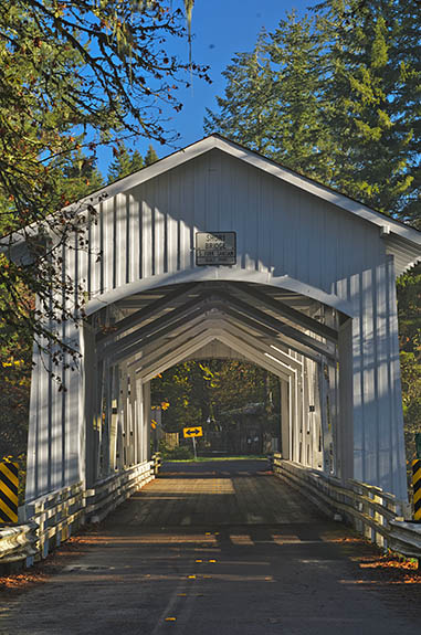 OR: Linn County, Cascades West Slope, South Santiam River Area, Short Covered Bridge. Covered bridge carrying traffic for a well-traveled county road. [Ask for #277.444.]