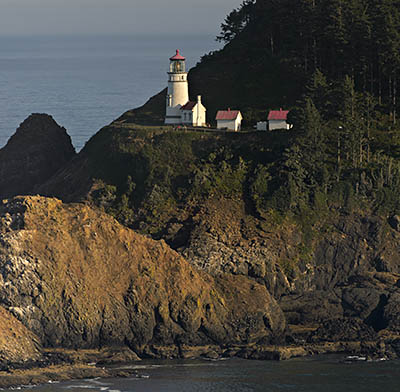 OR: South Coast Region, Lane County, Pacific Coast, Florence Area, Florence's North Coast, Heceta Head, View over the cliff-lined beaches of Cape Cove towards Heceta Head and it's lighthouse from US 101 [Ask for #278.533.]